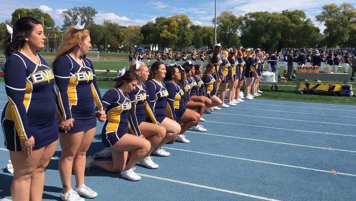 Buena Vista University cheerleaders kneel during the