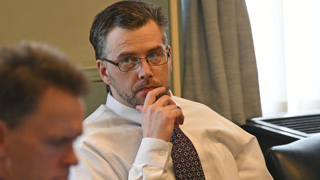 Shawn M. Grate sits in Common Pleas Court during voir dire of prosepective jurors during the first day of jury selection on Monday morning.
