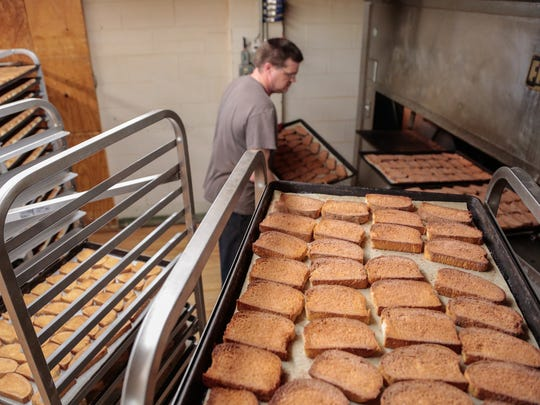 Anthony Stone works on loading trays of cinnamon toast to bake at Trenary Home Bakery on Tuesday Nov. 17, 2015.