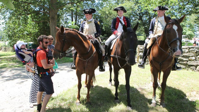 Visitors get up close and personal with period riders David Loda, Jackie Doherty and Hugh Francis during the Independence Day Fair at the John Jay Homestead in Katonah on Monday. The fair was sponsored by the Rotary Club of Bedford-Armonk and the homestead.