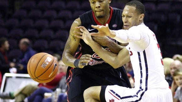 Mississippi guard Terence Smith, right, grimaces as the ball is knocked away by Southeast Missouri State guard Jarekious Bradley, left, in the second half of an NCAA college basketball game Monday, Dec. 22,  2014, in Southaven, Miss. Mississippi won 82-51. (AP Photo/Rogelio V. Solis)