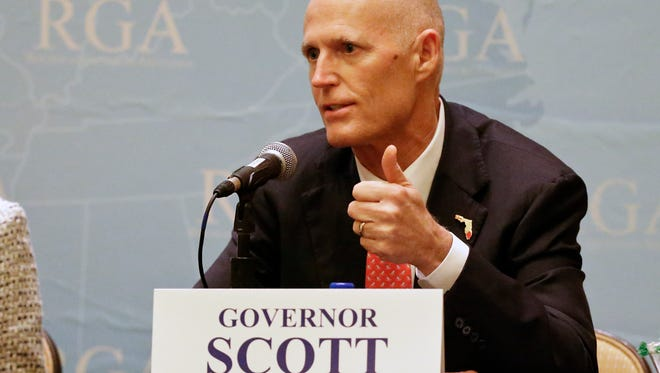 Florida Gov. Rick Scott answers questions during a news conference at the Republican Governors Association annual conference, Tuesday, Nov. 15, 2016, in Orlando, Fla. (AP Photo/John Raoux)