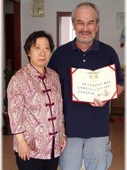 Grandmaster Wei with Ray Abeyta in Beijing, China.