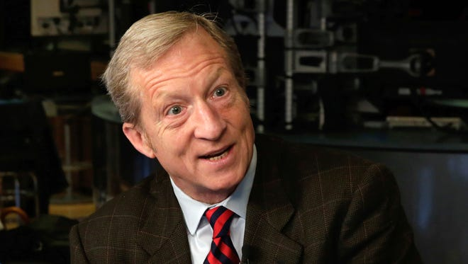In this April 2, 2018, file photo, billionaire environmentalist Tom Steyer is interviewed on Cheddar on the floor of the New York Stock Exchange.