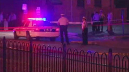 In this frame from video, police work at the scene of a shooting on Wednesday in Columbus, Ohio. Police in Ohio responding to a report of an armed robbery shot and killed a boy who they said pulled a gun from his waistband that was later determined to be a BB gun.