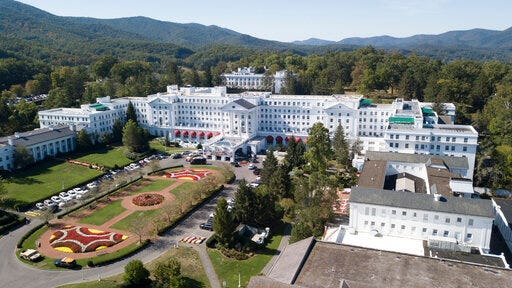 FILE - This Sept. 15, 2019, file photo shows The Greenbrier resort nestled in the mountains in White Sulphur Springs, W.Va. At least six of billionaire West Virginia Gov. Jim Justice family entities received the Paycheck Protection Program loans, meant to keep small businesses afloat during the coronavirus pandemic, including the governor's lavish resort The Greenbrier, as well as The Greenbrier Sporting Club, an exclusive members-only club linked to the resort.