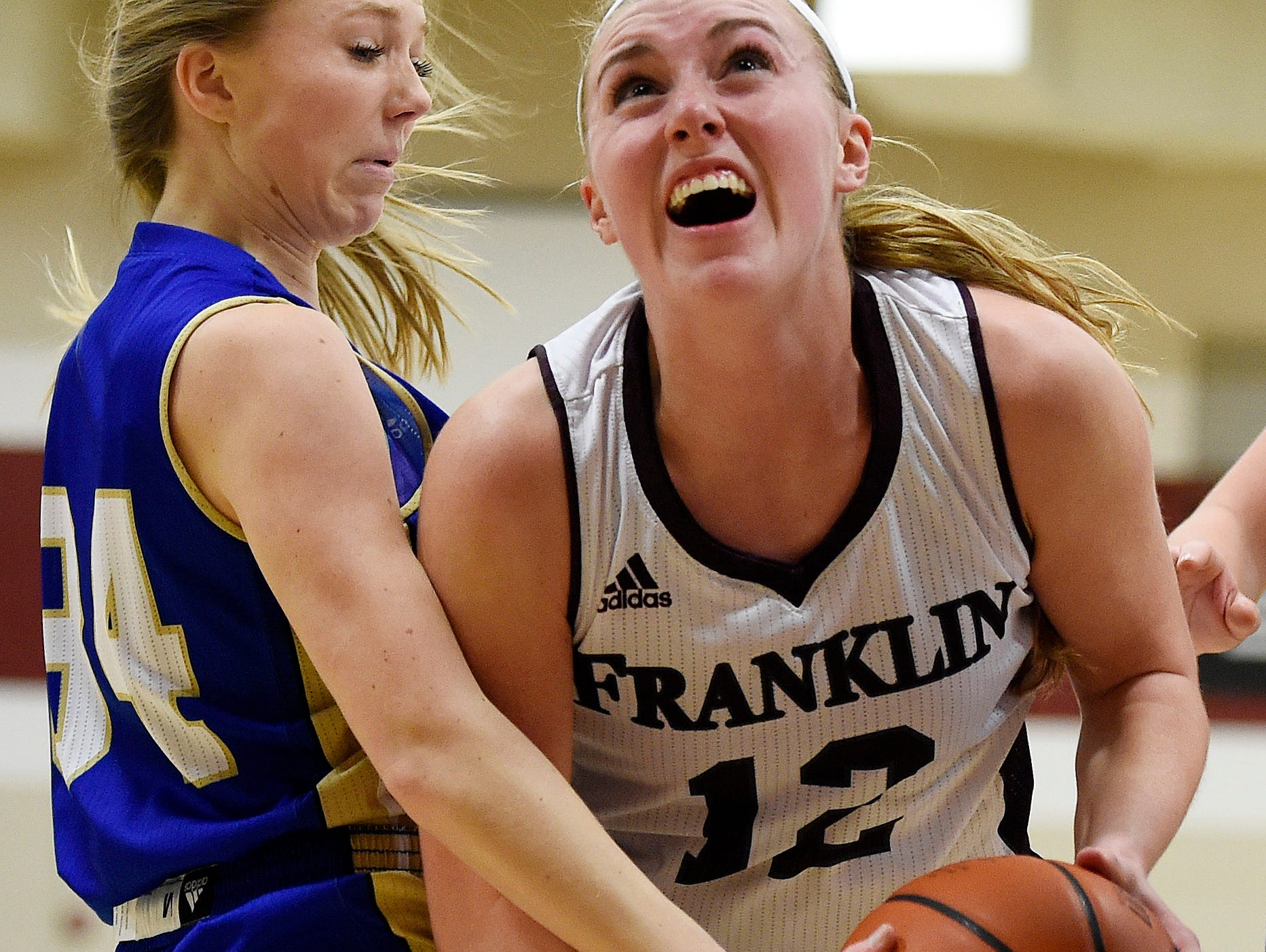 Franklin's Holly Harris (12) drives into Brentwood's Morgan Mevak (34) during the first half at Franklin High School, Tuesday, Feb. 16, 2016, in Franklin, Tenn.