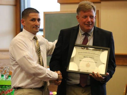Judge Bruce Winters, right, presents a certificate