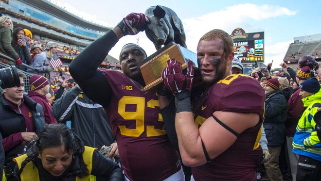 Minnesota players carry Floyd of Rosedale after a 51-14 pasting of Iowa last season, Kirk Ferentz's worst Big Ten loss in 15 years.