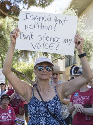 Sheila Scanlan attends a rally in support of the Save Our Schools petition at the Arizona Capitol on Aug. 12, 2017, in Phoenix.