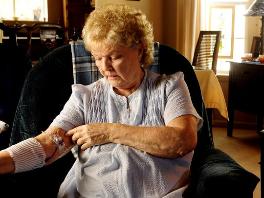 Even after a two week hospital stay, Nashvillian Joan Peay, at her home on Oct. 25, 2012, had to take medicine for fungal meningitis through an IV tube twice a day.