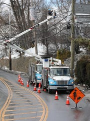 Con Edison crews work along West Main Street in Mount