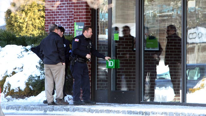 Greenburgh police investigate a bank robbery at the TD Bank on Central Park Avenue in Greenburgh, Feb. 10, 2017.