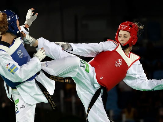 Jade Jones of Great Britain, right, and Nikita Glasnovic of Sweden compete in a women's Taekwondo 57-kg semifinal at the 2016 Summer Olympics in Rio de Janeiro, Brazil, Thursday, Aug. 18, 2016. (AP Photo/Andrew Medichini)