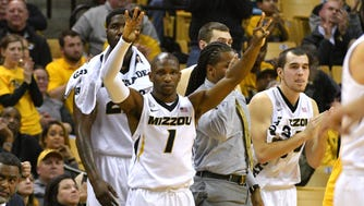 Missouri guard Terrence Phillips celebrates on the bench after the Tigers score against Tennessee.