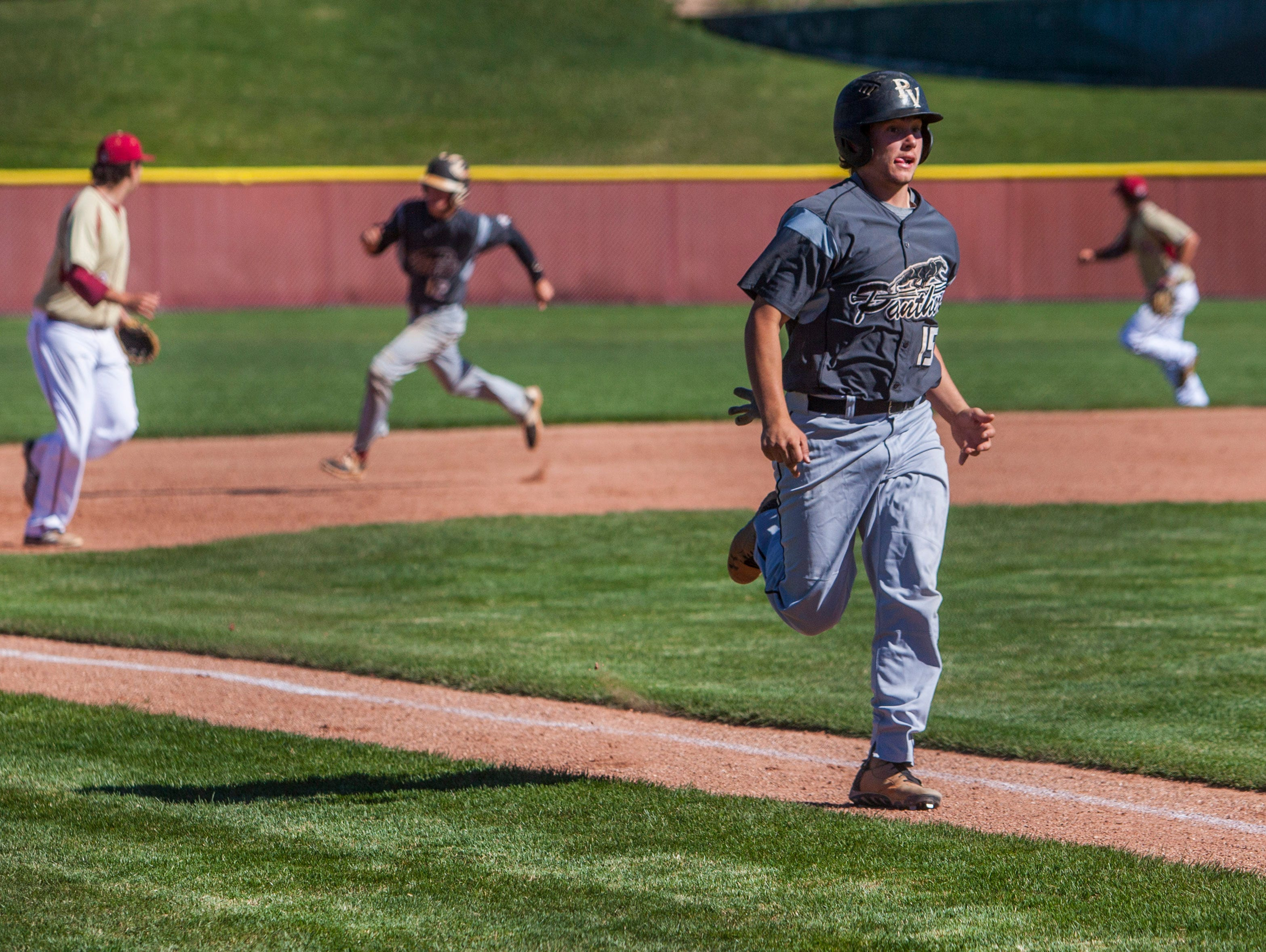 Pine View's Brooks Barney runs towards home plate during the game against Cedar, Tuesday, April 19, 2016.
