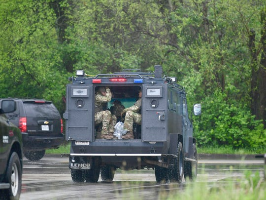 ATF personnel move to a new staging area Monday, April 23, 2018, in the parking lot at Church of Christ Burnette Chapel, scene of the 2017 Antioch church shooting. Law enforcement is searching for a second day for the gunman  who shot and killed four people early Sunday morning in a nearby Waffle House in Nashville, Tenn. The suspect is still at large.