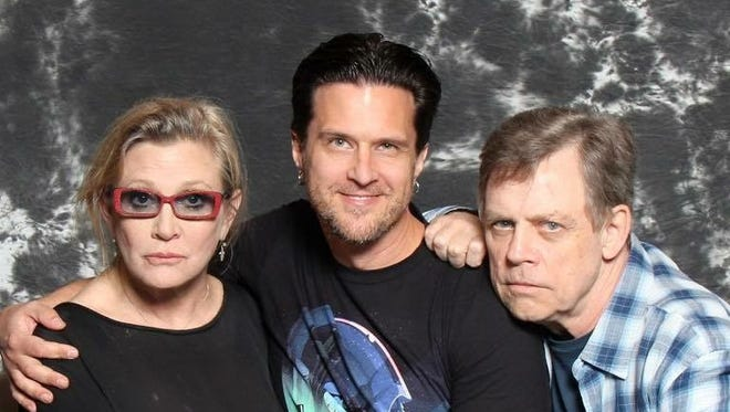 Livonia native Keith Sintay poses with Carrie Fisher, left, and Mark Hamill, right, in 2015. Hamill is well-known for playing Luke Skywalker in the Star Wars movies, and Carrie Fisher, who died this past week, is well-known for playing Princess Leia in the films.