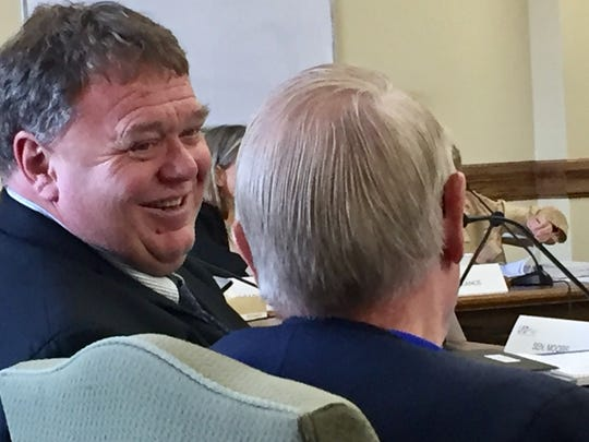 Sen. Llew Jones, R-Conrad, left, talks with Rep. Kenneth
