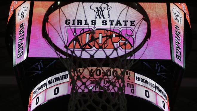The tourney logo silhouettes the net on the Resch Center scoreboard March 9, 2016, as the WIAA State GIrls Basketball tourney is set to begin.