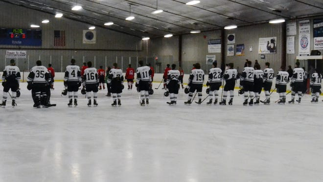 Brewster and Fox Lane players line up for the national anthem prior to a game at BIA.