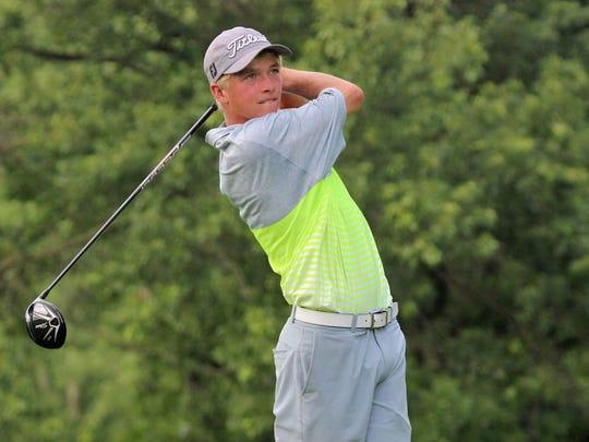 Castle freshman golfer Adam Bratton