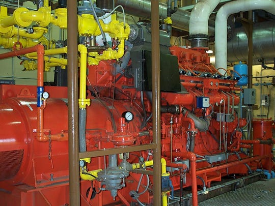 This cogeneration engine produces energy from methane gas captured from decomposing wastewater solids. A higher efficiency model is being designed that will produce 50% more energy.