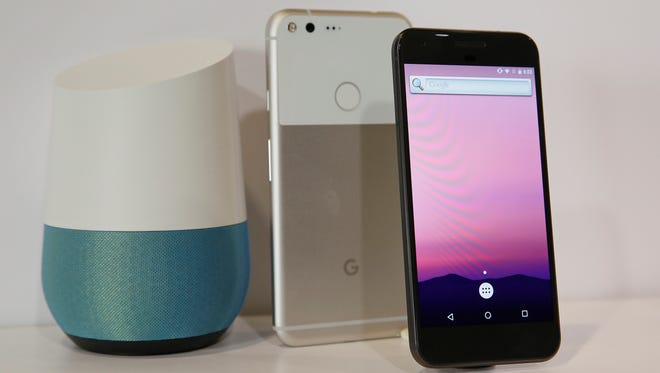 FILE - In this Oct. 4, 2016 file photo, the new Google Pixel phone is displayed next to a Google Home smart speaker, left, following a product event in San Francisco. Google's new smart speaker is at once a secretary, a librarian and a radio. If all this sounds familiar, it's because Amazon has been at it for about two years. Its Echo speaker can do what Home does and more, thanks to Amazon's head start in partnering with third-party services such as Domino's Pizza and Fitbit. But Home is smarter in a few other ways, as it taps what it knows about you from Gmail, Maps and other Google services.