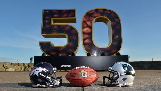 General view of Carolina Panthers and Denver Broncos helmets with NFL Wilson Duke football at Super Bowl 50 sculpture at Twin Peaks.