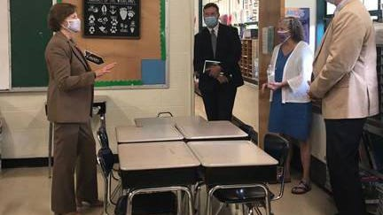 U.S. Sen. Jeanne Shaheen, left, meets with Rochester leaders Wednesday as they view classrooms set up to conform to social distancing guidelines at the Chamberlain Street School in Rochester.