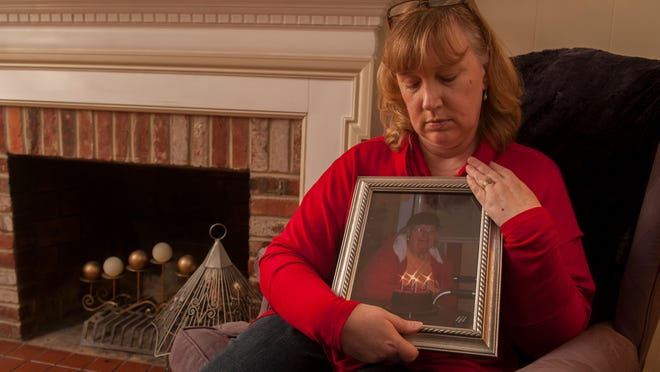 Denise Colaiacovo of Cherry Hill holds a photo of her mother Patricia Markley, who passed away on Dec. 6, 2013. Colaiacovo knew her mother didn't want extraordinary medical intervention to prolong her life, and had an advance directive to prove it. But when her mother's oxygen levels dipped too low, she was rushed to the nearest emergency room and put on a ventilator anyway. Her mother lived another two months in a nursing home, without any quality of life.