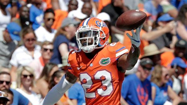 Florida defensive back Chauncey Gardner-Johnson of Cocoa celebrates after a play during an NCAA college football spring intrasquad game, Saturday, April 14, 2018, in Gainesville, Fla. (AP Photo/John Raoux)
