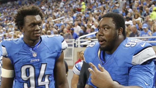 Detroit Lions defensive lineman left to right Ezekiel Ansah and Nick Fairley.