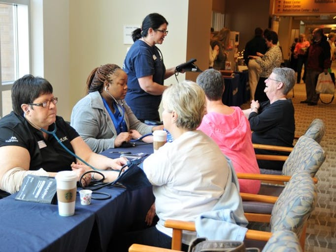 Attendees of the 13th annual Women's Health 101 have their blood pressure taken on Saturday, March 15, at the CentraCare Health Plaza in St. Cloud.