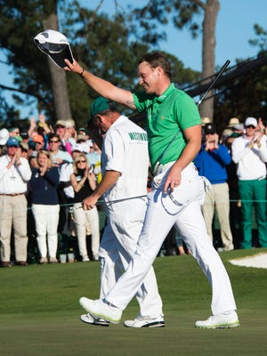 England's Danny Willett celebrates on the 18th green during Round 4 of the 80th Masters Golf Tournament at the Augusta National Golf Club on April 10, 2016, in Augusta, Georgia. England's Danny Willett won the 80th Masters at Augusta National on Sunday for his first major title.