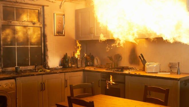 Fire raging in a kitchen.
