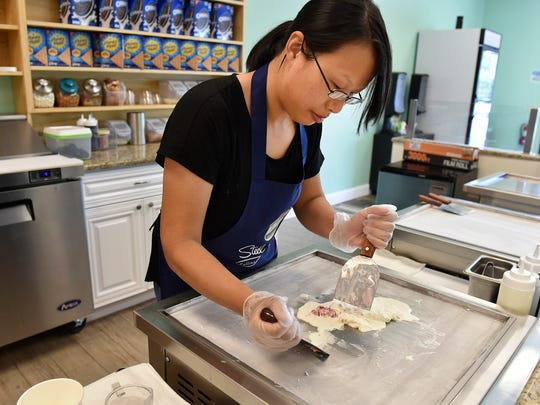 """Tanya Ye, a Vero Beach resident who immigrated from China, creates a serving of Pink Berry rolled ice cream inside her store, Steel N Roll, Rolling Ice Cream & More, at 1820 58th Avenue, on Thursday, July 11, 2018, in Indian River County. """"I like ice cream,"""" Ye said about opening her own store. """"After two months I already got a lot of customers."""" Ye sought help from Literacy Services of Indian River County to improve her English."""