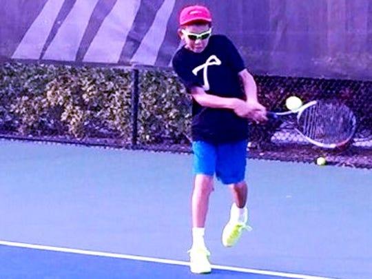 Milford's Aidan Kim unloads for a backhand in last month's Eddie Herr International Junior Tournament in Bradenton, Fla.