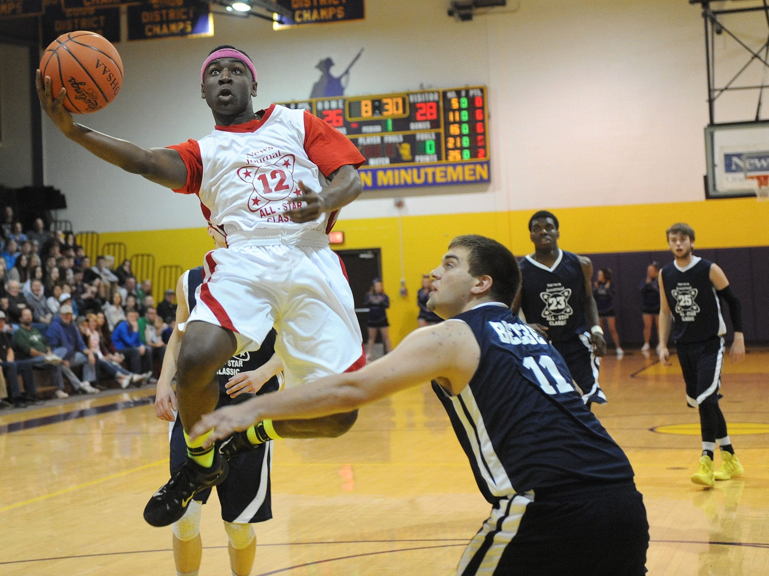 Asante Wilder floats toward the basket for a shot during the 37th annual News Journal All-Star Basketball Classic at Lexington High School.