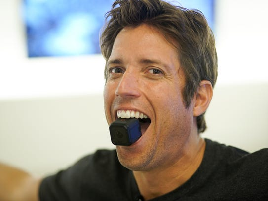 GoPro CEO Nick Woodman with the Hero4 Session camera.