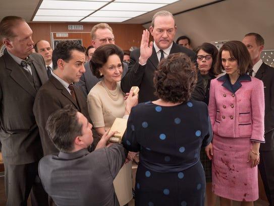 Lyndon B. Johnson (John Carroll Lynch, center) is sworn