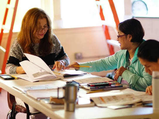 Sonia Rodriguez (left) and Isabel Moveno work together