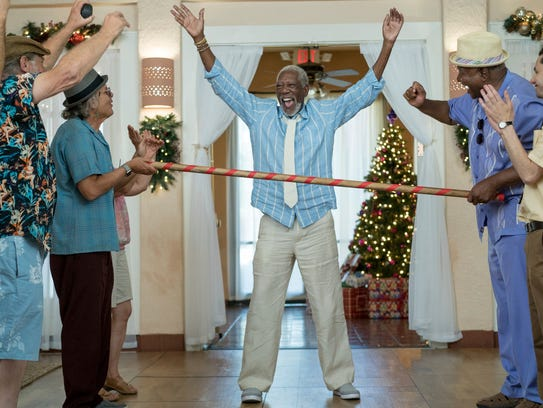 Morgan Freeman (center) is the life of the party in