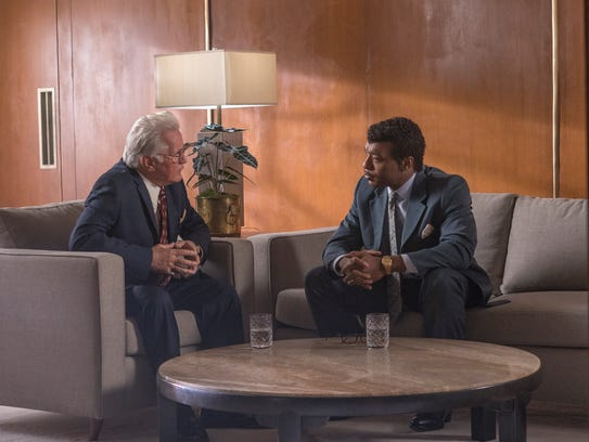 Oral Roberts (Martin Sheen, left) meets with Bishop