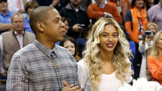 One of Jay Z and Beyoncé's favorite pasttimes is attending NBA games -- especially when they can support his home team, the Brooklyn Nets. Here, they take in a game in Oklahoma City last November.