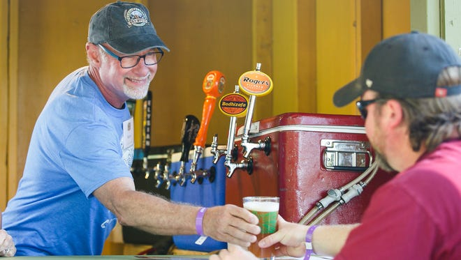 Morry Jones serves up a pint at the Oregon Garden Brewfest on Saturday, June 17, 2017, in Silverton, Ore.