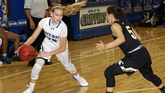 Gateway's Addison Potts looks for a way to dribble around the defense of Bishop Verot's Catherine Reszel during the Region 5A-10 girls basketball final won by Gateway 37-34.