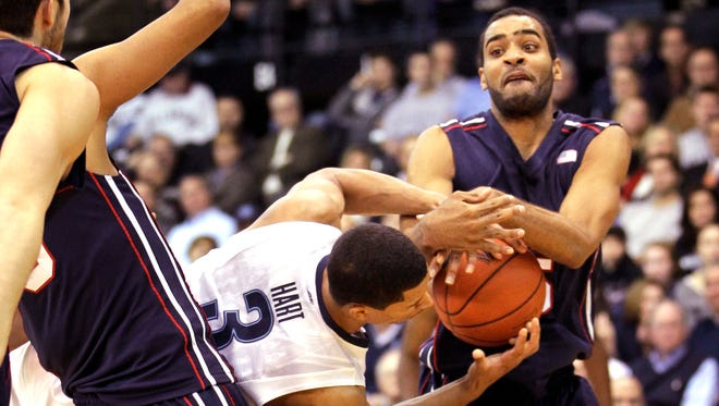 Villanova's Josh Hart and Penn's Julian Harrell fight for possession of the ball in the first half.