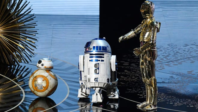 Star Wars droid characters BB8, R2D2 and C3P0 make an appearance at the Academy Awards.