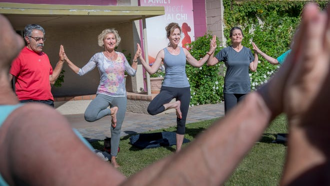 From left, Tom Moroun, Owner Mary Beth, Suzanne Ticknor and Cindy Burnington in a combination meditation and yoga class at the Desert Song Healing Arts Center in central Phoenix.